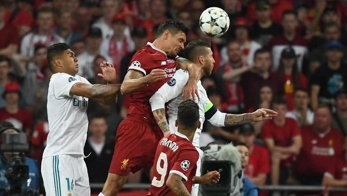 Liverpools Croatian defender Dejan Lovren (2L) jumps for the ball with Real Madrids Spanish defender Sergio Ramos (R)  during the UEFA Champions League final football match between Liverpool and Real Madrid at the Olympic Stadium in Kiev, Ukraine, on May 26, 2018. (Photo by FRANCK FIFE / AFP)