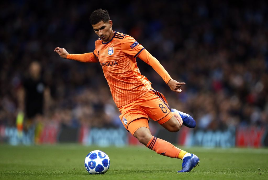 MANCHESTER, ENGLAND - SEPTEMBER 19: Houssem Aouar of Lyon runs with the ball during the Group F match of the UEFA Champions League between Manchester City and Olympique Lyonnais at Etihad Stadium on September 19, 2018 in Manchester, United Kingdom.  (Photo by Julian Finney/Getty Images)