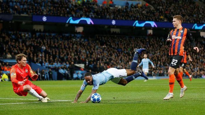Josep Guardiola mengaku kalau Manchester City tak seharusnya dapat penalti dari insiden yang terjadi pada Raheem Sterling (Andrew Yates/Reuters)