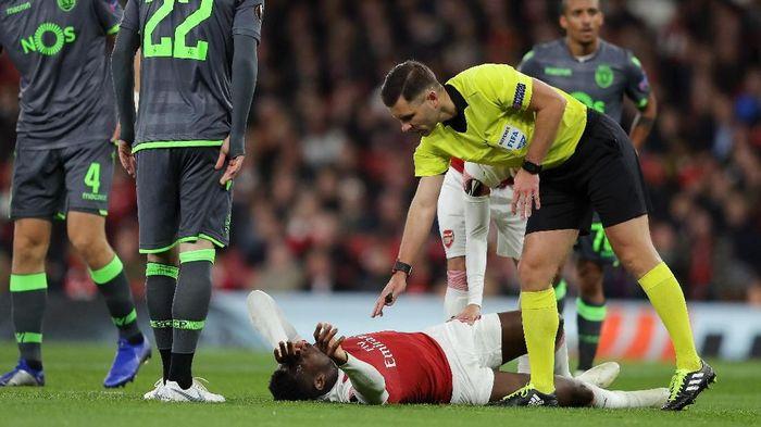 Danny Welbeck mengalami cedera saat Arsenal menghadapi Sporting di Liga Europa (Foto: Richard Heathcote/Getty Images)