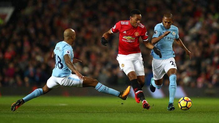Kata Robbie Fowler, Liverpool jangan berharap Mancheter United bisa menjegal Manchester City. (Michael Steele/Getty Images)