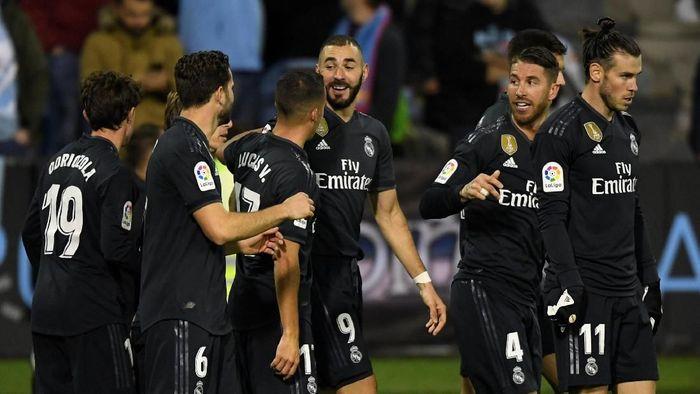 Pemain-pemain Real Madrid. (Foto: Eloy Alonso/Reuters)