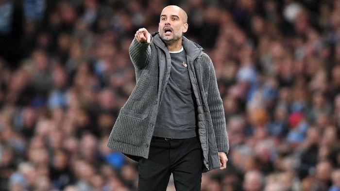 Pep Guardiola mewanti-wanti Manchester City untuk tak lengah saat menjamu Liverpool. (Foto: Laurence Griffiths/Getty Images)