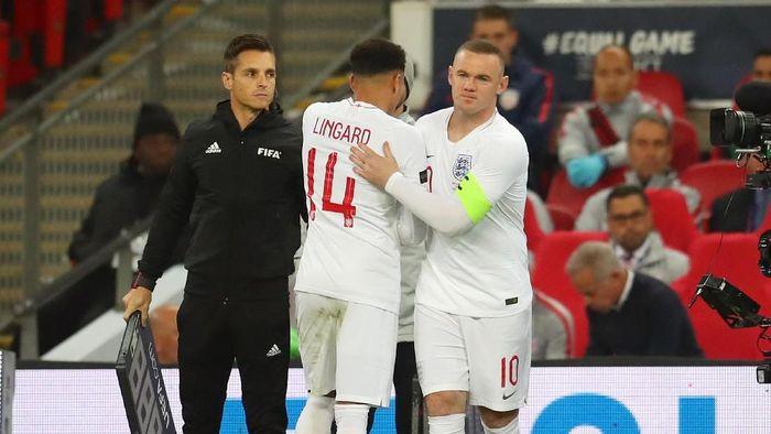 Gareth Southgate memberi kesempatan untuk Rooney memainkan laga terakhirnya. Rooney masuk menggantikann Jesse Lingard di menit ke-58. (Foto: Catherine Ivill/Getty Images)