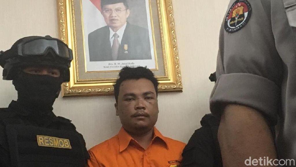 Berbaju Tahanan, Ini Haris Simamora Tersangka Pembunuh Satu Keluarga