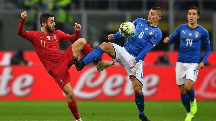 Portugal lolos ke semifinal UEFA Nations League usai bermain imbang 0-0 dengan Italia (Foto: Valerio Pennicino/Getty Images)