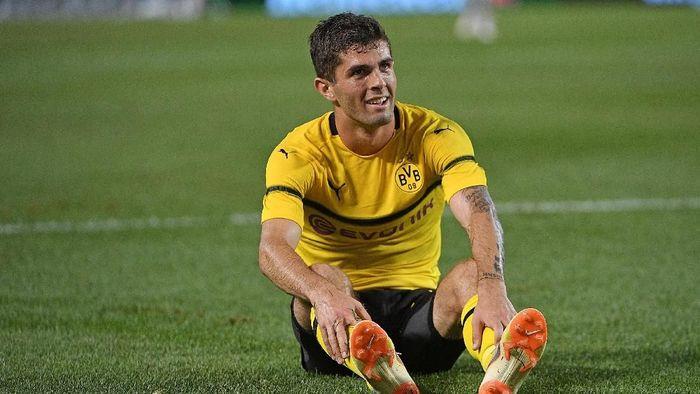 Christian Pulisic dipastikan tetap di Dortmund sampai akhir musim (Justin Berl/Getty Images)