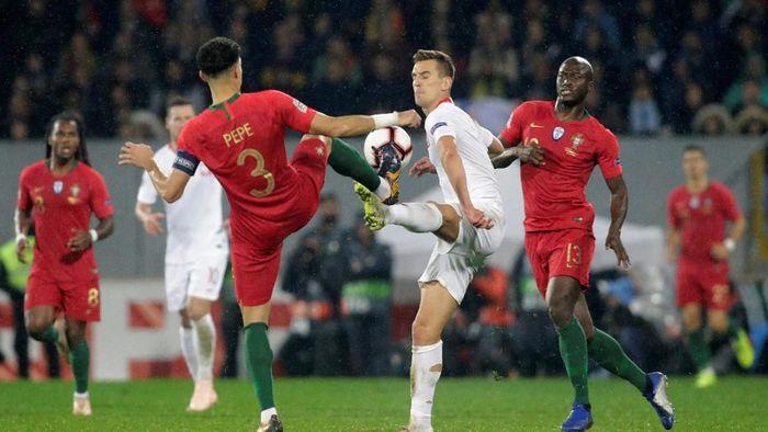 Portugal berimbang tanpa gol kontra Polandia di laga terakhir UEFA Nations League (REUTERS/Miguel Vidal)