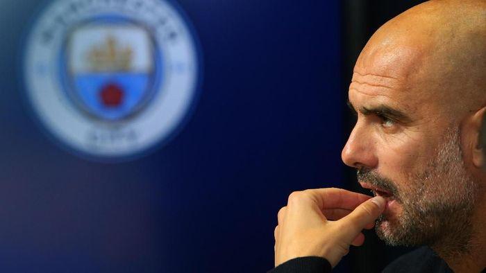 Pep Guardiola menilai persaingan perebutan gelar juara Liga Inggris musim ini akan sengit (Foto: Alex Livesey/Getty Images)