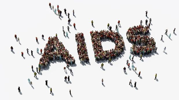 Human crowd forming  AIDS text on white background. Horizontal  composition with copy space. Directly above. Clipping path is included. AIDS awareness concept.