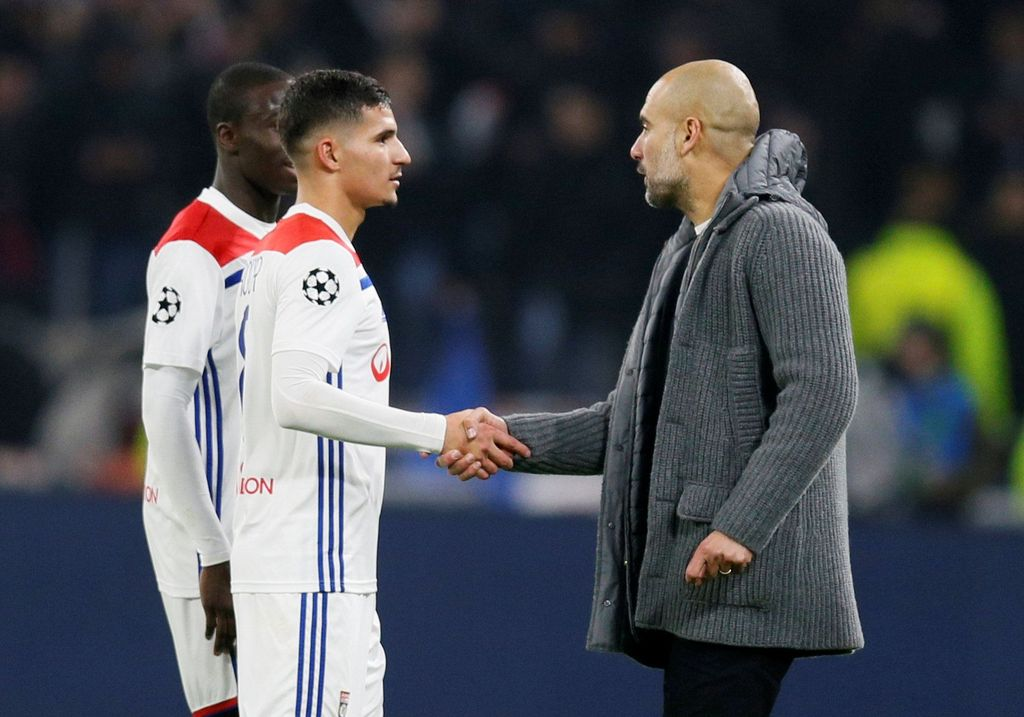 Soccer Football - Champions League - Group Stage - Group F - Olympique Lyonnais v Manchester City - Groupama Stadium, Lyon, France - November 27, 2018  Manchester City manager Pep Guardiola shakes the hand of Lyon's Houssem Aouar after the match            REUTERS/Emmanuel Foudrot