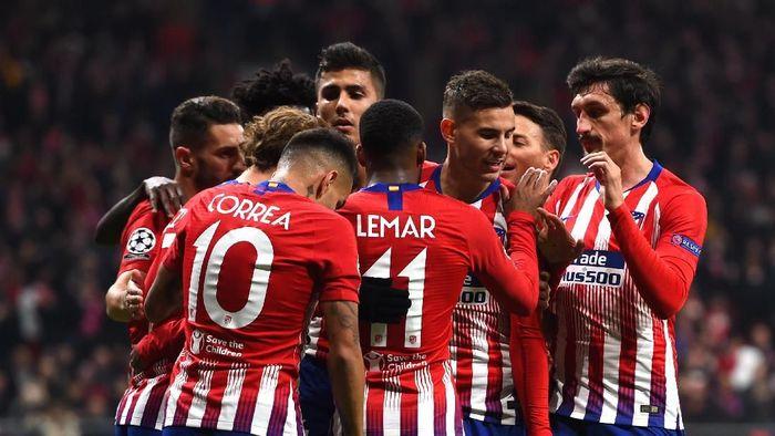 Atletico Madrid lolos ke babak 16 besar Liga Champions usai mengalahkan AS Monaco 2-0 di matchday kelima Grup A. (Foto: Denis Doyle/Getty Images)