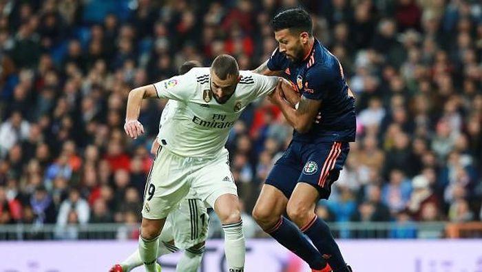 Real Madrid saat menghadapi Valencia di Bernabeu pada pertemuan pertama (Gonzalo Arroyo Moreno/Getty Images)