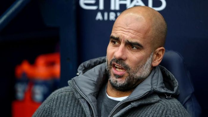 Pep Guardiola menolak bicara soal kans Manchester City raih quadruple. (Foto: Clive Brunskill/Getty Images)