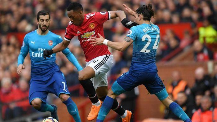 Manchester United akan menjamu Arsenal di Liga Inggris tengah pekan ini (Foto: Shaun Botterill/Getty Images)