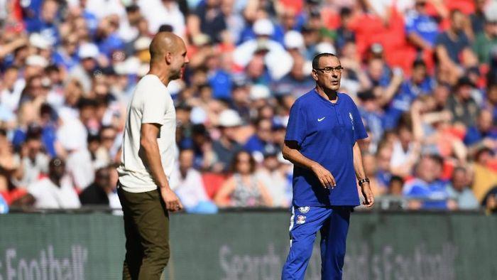 Maurizio Sarri dan Pep Guardiola akan berhadapan akhir pekan ini (Clive Mason/Getty Images)