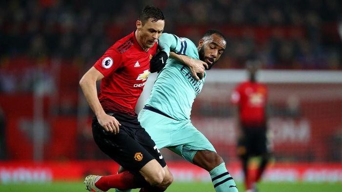 Manchester United berimbang kontra Arsenal. (Foto: Clive Brunskill/Getty Images)