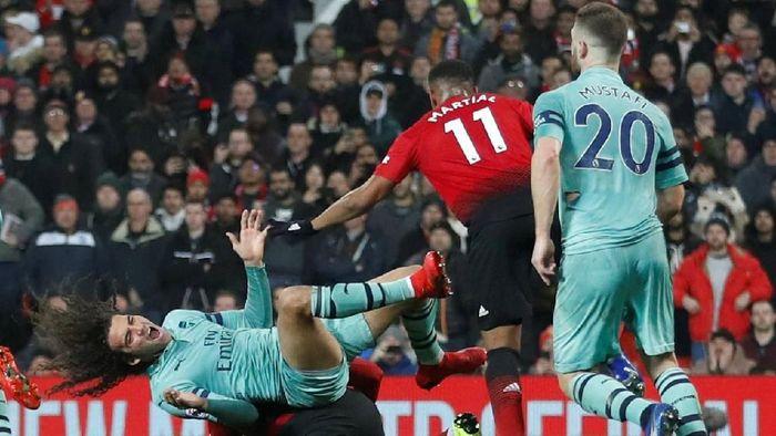Manchester United berimbang 2-2 saat menjamu Arsenal (Reuters)