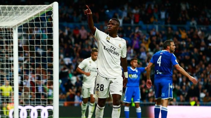 Pemain Real Madrid, Vinicius Junior, merayakan gol ke gawang Melilla. (Foto: Gonzalo Arroyo Moreno/Getty Images)