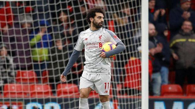 Mohamed Salah kini berdiri di puncak daftar topskorer Premier League bersama Aubameyang