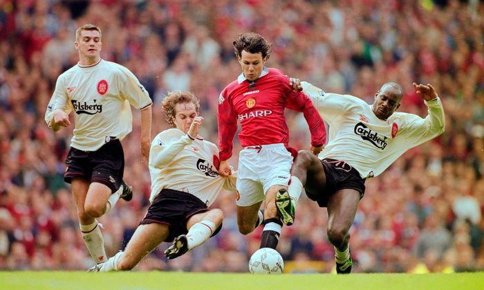 MANCHESTER, UNITED KINGDOM - OCTOBER 12:  Manchester United winger Ryan Giggs is challenged by Jason McAteer (2nd l) and Michael Thomas (r) as Dominic Matteo (l) looks on during the FA Premier League match between Manchester United and Liverpool at Old Trafford on October 12, 1996 in Mnachester, Engand. (Photo by Clive Brunskill/Allsport/Getty Images)