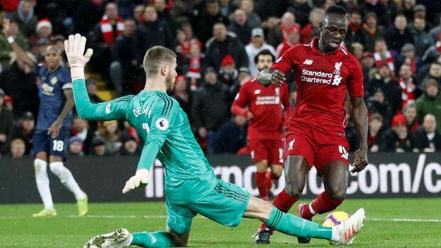 Man United kalah 1-3 dari Liverpool.