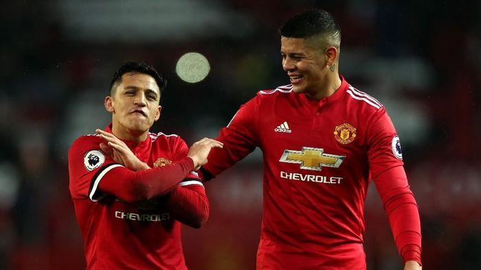 Alexis Sanchez dan Marcus Rojo bakal ditendang dari Man United musim panas nanti? (Alex Morton/Getty Images)