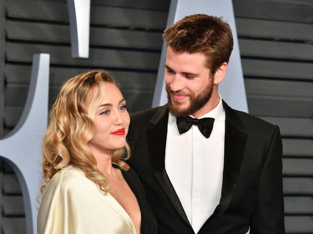 Alasan Miley Cyrus dan Liam Hemsworth Rahasiakan Pernikahan