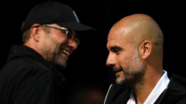 Josep Guardiola dan Juergen Klopp (Stu Forster/Getty Images)