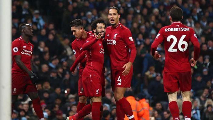 Liverpool melelang jersey untuk disumbangkan ke korban gempa dan tsunami Palu. (Foto: Clive Brunskill/Getty Images)