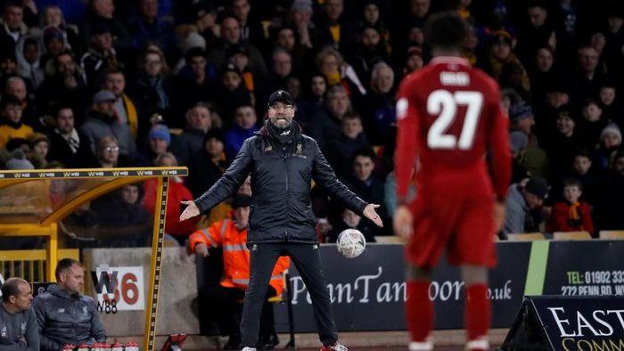 Juergen Klopp menilai Liverpool tak akan diuntungkan dalam perburuan gelar Liga Inggris usai tersingkir dari Piala FA (Foto: Action Images via Reuters/Carl Recine)
