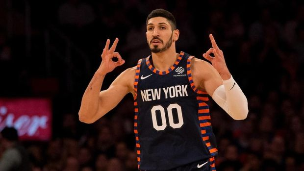 NEW YORK, NY - DECEMBER 25: Enes Kanter #00 of the New York Knicks celebrates after hitting a three-point basket against the Milwaukee Bucks at Madison Square Garden on December 25, 2018 in New York City. NOTE TO USER: User expressly acknowledges and agrees that, by downloading and or using this photograph, User is consenting to the terms and conditions of the Getty Images License Agreement.   Mike Stobe/Getty Images/AFP