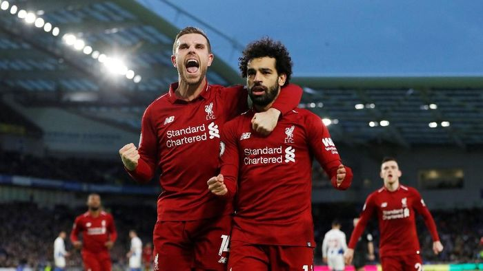 Soccer Football - Premier League - Brighton & Hove Albion v Liverpool - The American Express Community Stadium, Brighton, Britain - January 12, 2019  Liverpools Mohamed Salah celebrates scoring their first goal with Jordan Henderson   Action Images via Reuters/Paul Childs  EDITORIAL USE ONLY. No use with unauthorized audio, video, data, fixture lists, club/league logos or