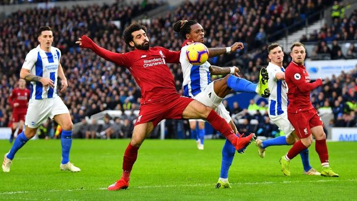 Soccer Football - Premier League - Brighton & Hove Albion v Liverpool - The American Express Community Stadium, Brighton, Britain - January 12, 2019  Liverpools Mohamed Salah in action with Brightons Gaetan Bong   REUTERS/Dylan Martinez  EDITORIAL USE ONLY. No use with unauthorized audio, video, data, fixture lists, club/league logos or