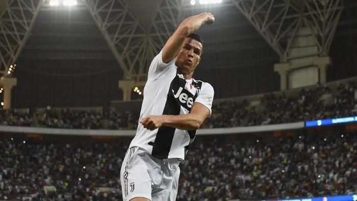 Cristiano Ronaldo mencetak gol penentu kemenangan Juventus atas AC Milan di Piala Super Italia 2018 (Foto: Claudio Villa/Getty Images for Lega Serie A)