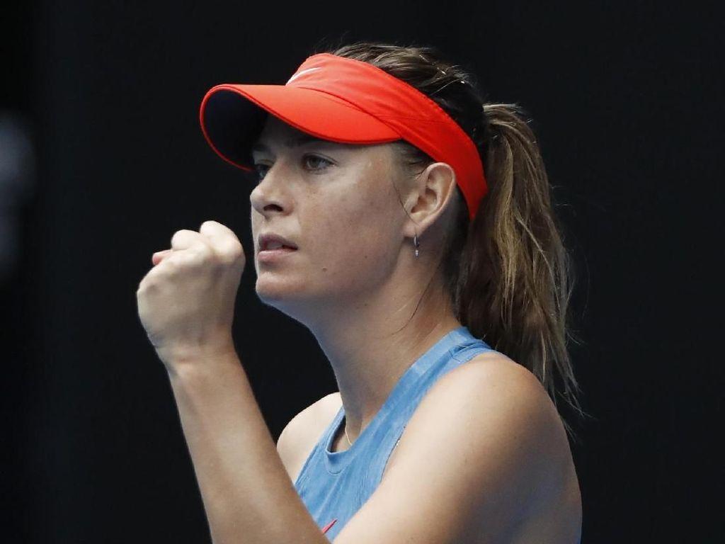 Sharapova Singkirkan Wozniacki