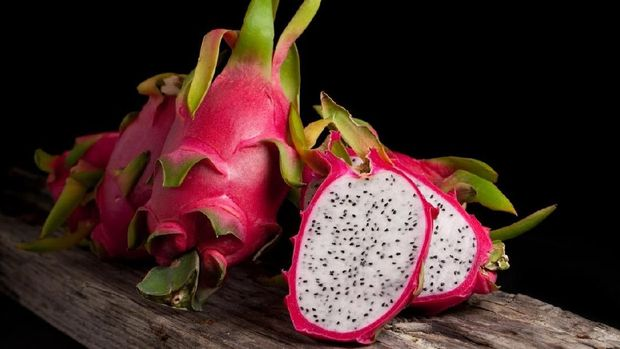 Dragon fruit smoothie on wooden table.food healthy