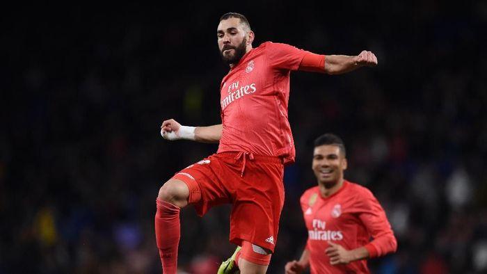 Karim Benzema mencetak dua gol saat Real Madrid kalahkan Espanyol 4-2 (Foto: Alex Caparros/Getty Images)