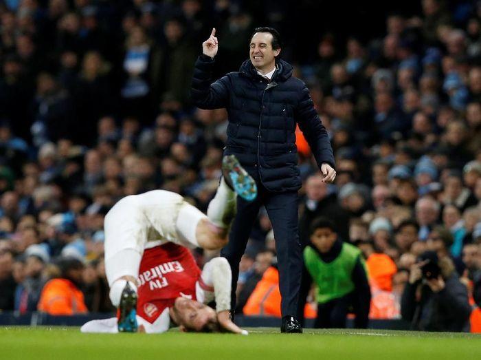 Untuk finis empat besar, Arsenal disebut akan butuh bantuan dari rival-rivalnya. Foto: Andrew Yates/ Reuters