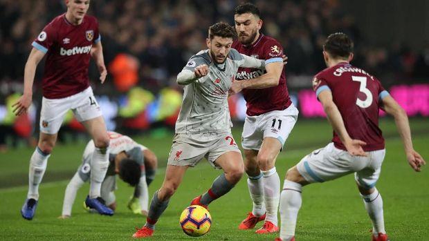 Liverpool mengalami kesulitan di markas West Ham.