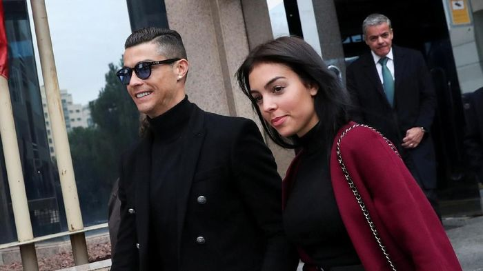 Portugals soccer player Cristiano Ronaldo leaves with his girlfriend Georgina Rodriguez after appearing in court on a trial for tax fraud in Madrid, Spain, January 22, 2019. REUTERS/Susana Vera
