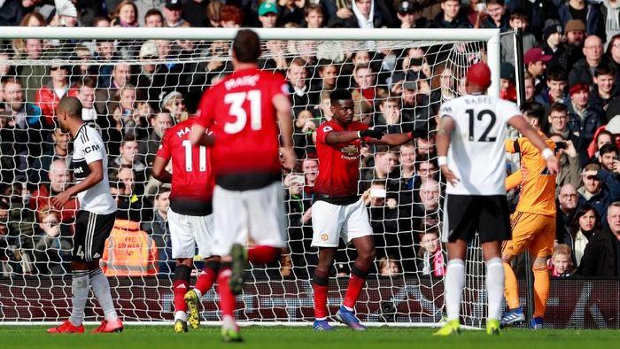 Paul Pogba sumbang dua gol dalam kemenangan 3-0 Manchester United atas Fulham. (Foto: Andrew Couldridge/Reuters)