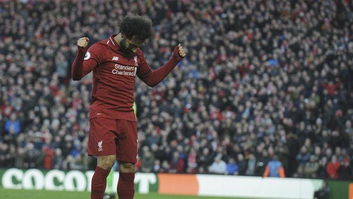 Mohamed Salah tak ingin fokus terpecah menejlang pekan yang padat. (AP Photo/Rui Vieira)