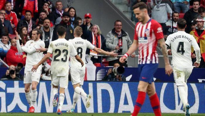 Aksi penyerang Real Madrid Gareth Bale saat merayakan golnya ke gawang Atletico Madrid. (Foto: Susana Vera/Reuters)