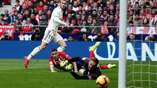 Tampil bukan sebagai starter, Gareth Bale masih bisa mencetak gol ke gawang Atletico Madrid. (