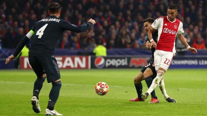 Ajax vs Madrid selesai dengan skor 1-2. Semua gol di Johan Cruyff Stadium, Kamis (14/2/2019) dinihari WIB, dibukukan pada babak kedua. (Foto: Dean Mouhtaropoulos/Getty Images)