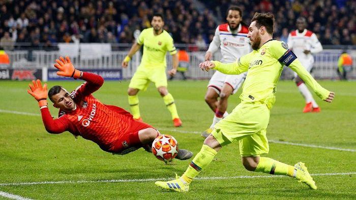 Laga Lyon vs Barcelona di leg pertama babak 16 besar Liga Champions berakhir 0-0 (Foto: Emmanuel Foudrot/Reuters)