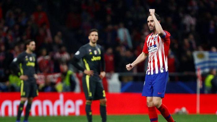 Diego Godin mencetak satu gol saat Atletico Madrid menang 2-0 atas Juventus di leg pertama babak 16 besar Liga Champions (Foto: Juan Medina/Reuters)