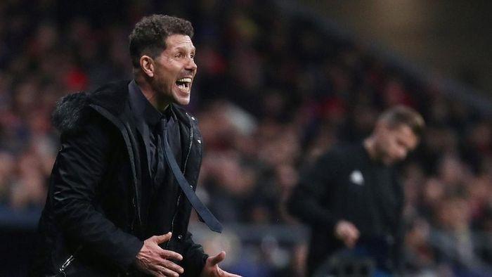 Diego Simeone didakwa UEFA karena merayakan gol Atletico Madrid secara tidak pantas. Foto: REUTERS/Sergio Perez