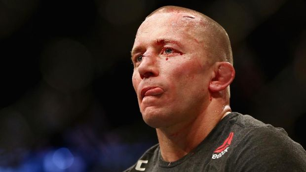 NEW YORK, NY - NOVEMBER 04: Georges St-Pierre of Canada reacts following his victory over Michael Bisping of England in their UFC middleweight championship bout during the UFC 217 event at Madison Square Garden on November 4, 2017 in New York City.   Mike Stobe/Getty Images/AFP